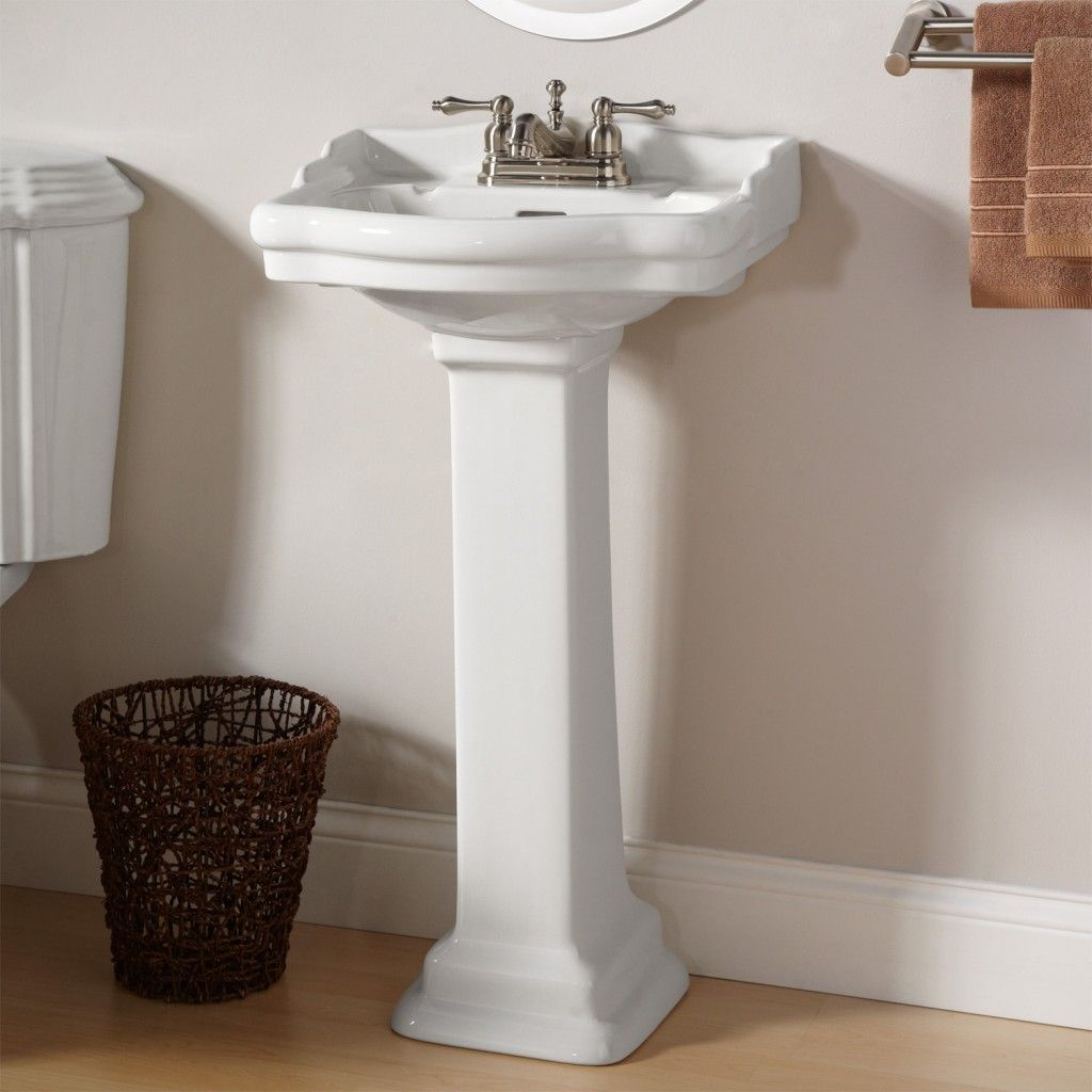 Beautiful small pedestal sinks for powder room.