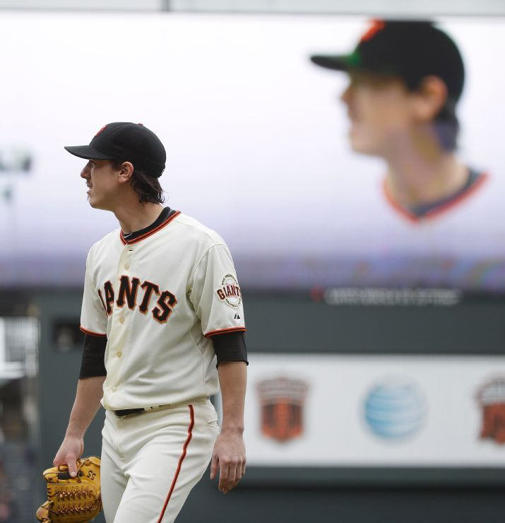 San Francisco Giants starting pitcher Tim Lincecum walks back to the dugout after throwing in the eighth inning of their baseball game against the San Diego Padres Wednesday, June 25, 2014, in San Francisco. Lincecum threw his second career no-hitter as San Francisco won 4-0. (AP Photo/Eric Risberg)