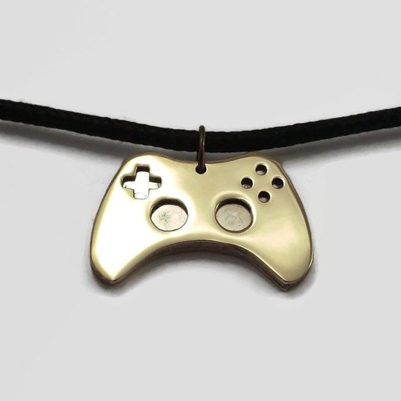 This stylish game controller pendant necklace is a great gamer gift this stylish game controller pendant necklace is a great gamer gift the ideal jewelry piece to show your love of video games a brass and stainless steel aloadofball Choice Image