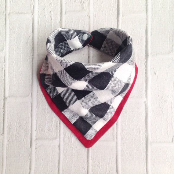 This is a flannel bandana bib that acts as a scarf for the cold, catches all of that drool while being more stylish than your average bib. You can also