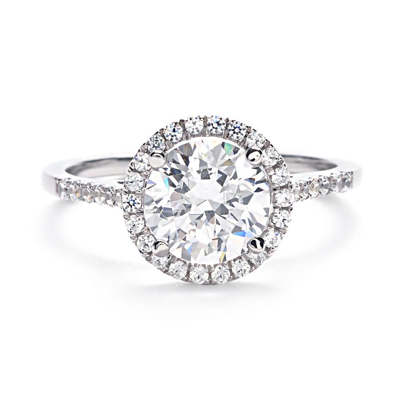 Classically gorgeous, this round brilliant diamond ...