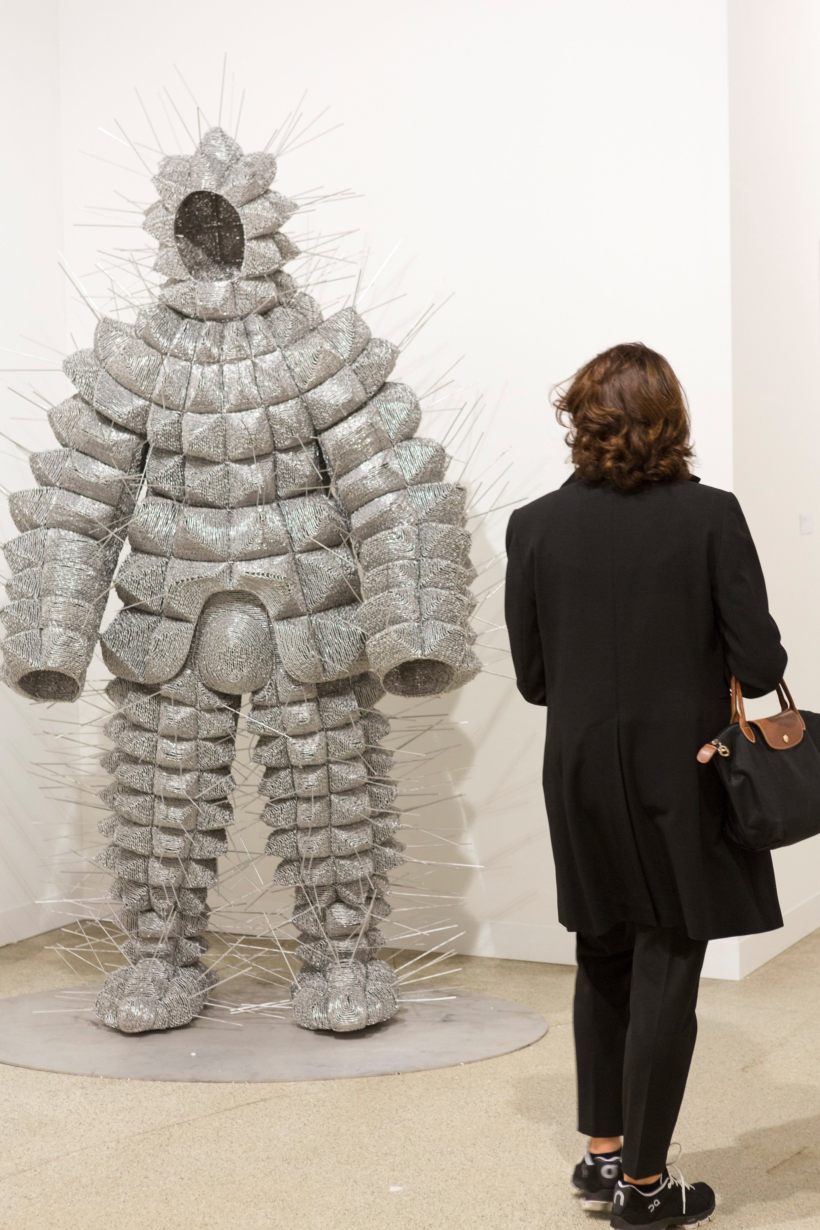 Catterpillar suit by Walter Oltmann, presented by the Goodman Gallery at Art Basel, 2016