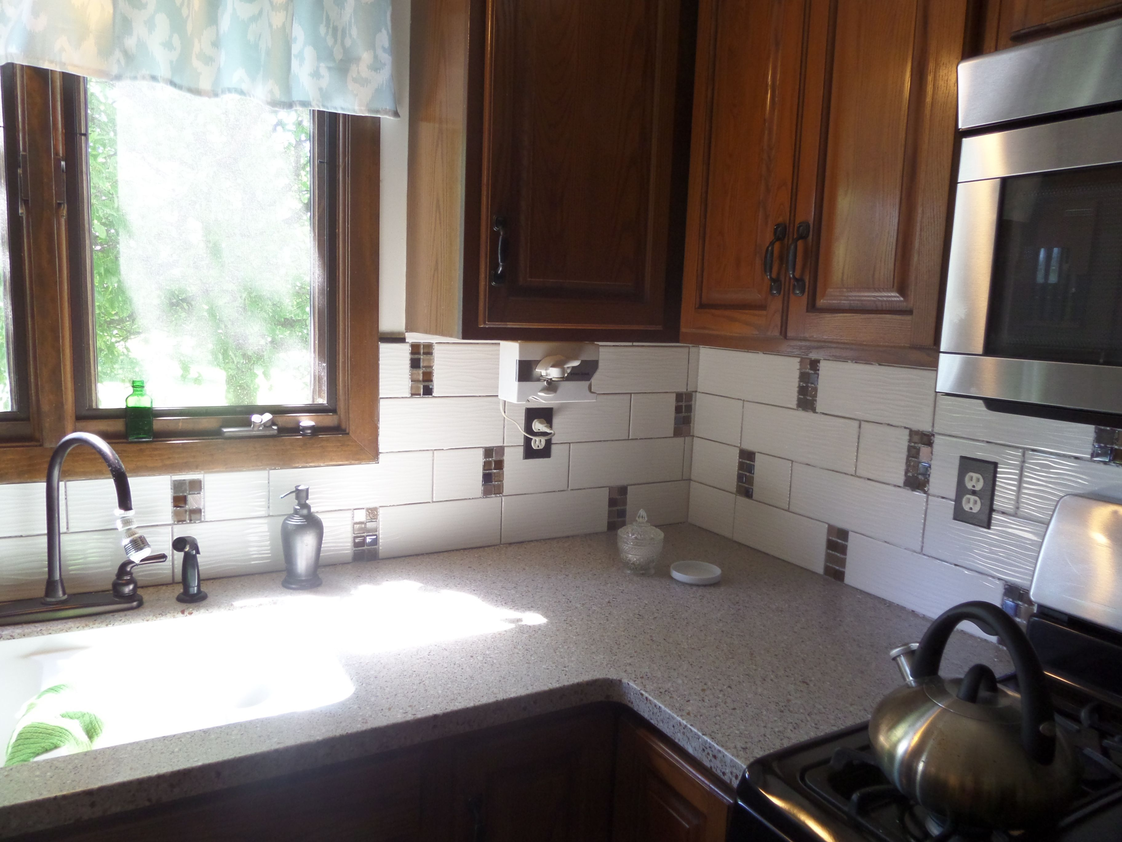 Quartz counter LG Sugarloaf large wavy subway tiles and mosaic