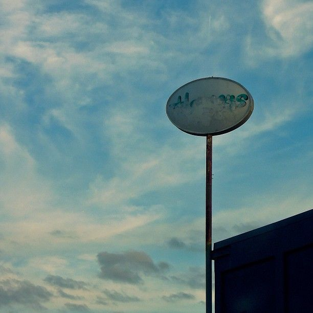 #coverup #ovalsign #sign #signage #sky #clouds #type #typography #signeraser #redacted #redactedsign #igsignage #ig_signage