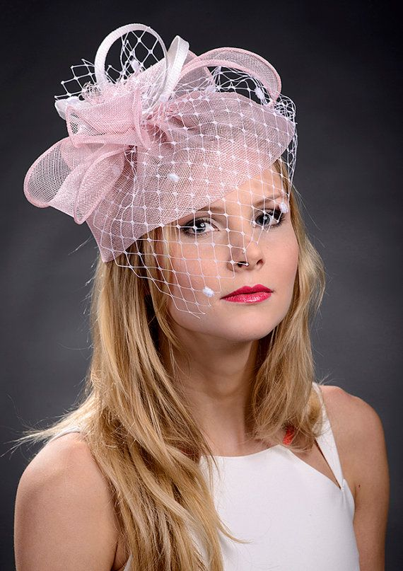 Pink fascinator with spot veiling 7b496ded577