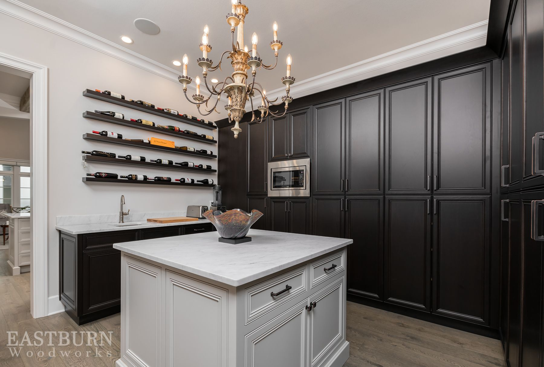 Dark stained kitchen pantry cabinets with custom wine storage and