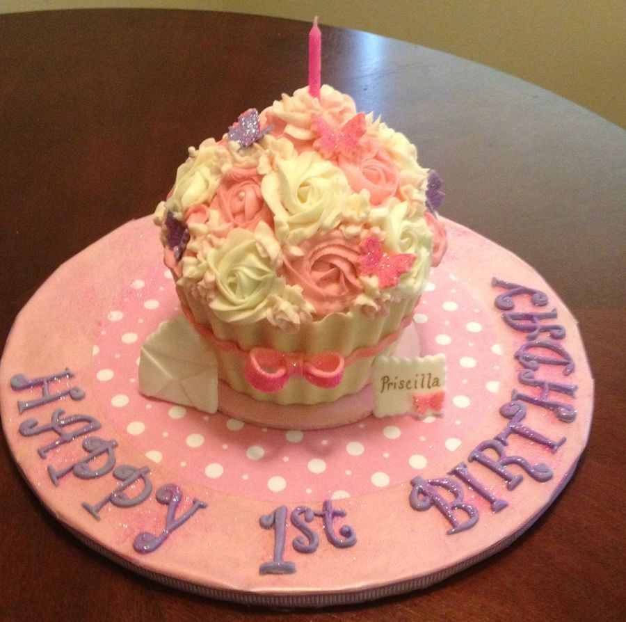 Smash Cake For A Little Girls 1st Birthday Cupcake Liner Is White
