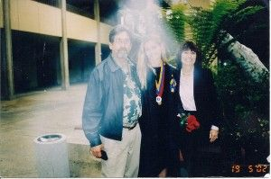 Jody Sharpe was attending her daughter's Graduation with her husband Steve - they all posed for pics and she asked that her deceased daughter make an appearance if she could - they all believe the mist in the pic surrounding them is her other daughter showing up, who is deceased. Jody feels it's amazing proof of after-death communication....
