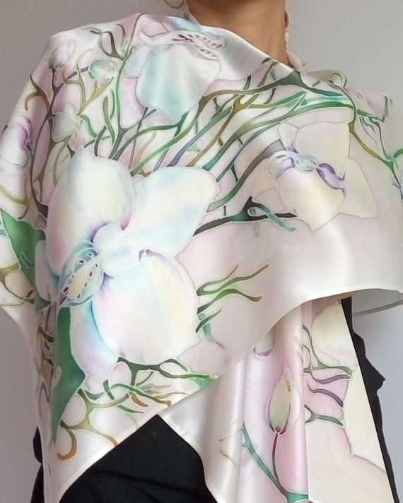 Handpainted silk scarf Painted silk Batik Orchids Silk shawl Flower art scarves Bridesmaids gift Women fashion scarf Wedding gift Birthday  Hand painted silk scarf with Orchids flowers. Painted on a pure silk dense fabric, has a glossy shine. Painted by special professional paints that do not wash off and fixed steam .It is hand painted with fabric dyes ( cold batik technique).  dimension 79 by 18 or 200cm/45cm  Edge scarf neatly sutured manually.   Hand wash delicate mild detergent in warm…