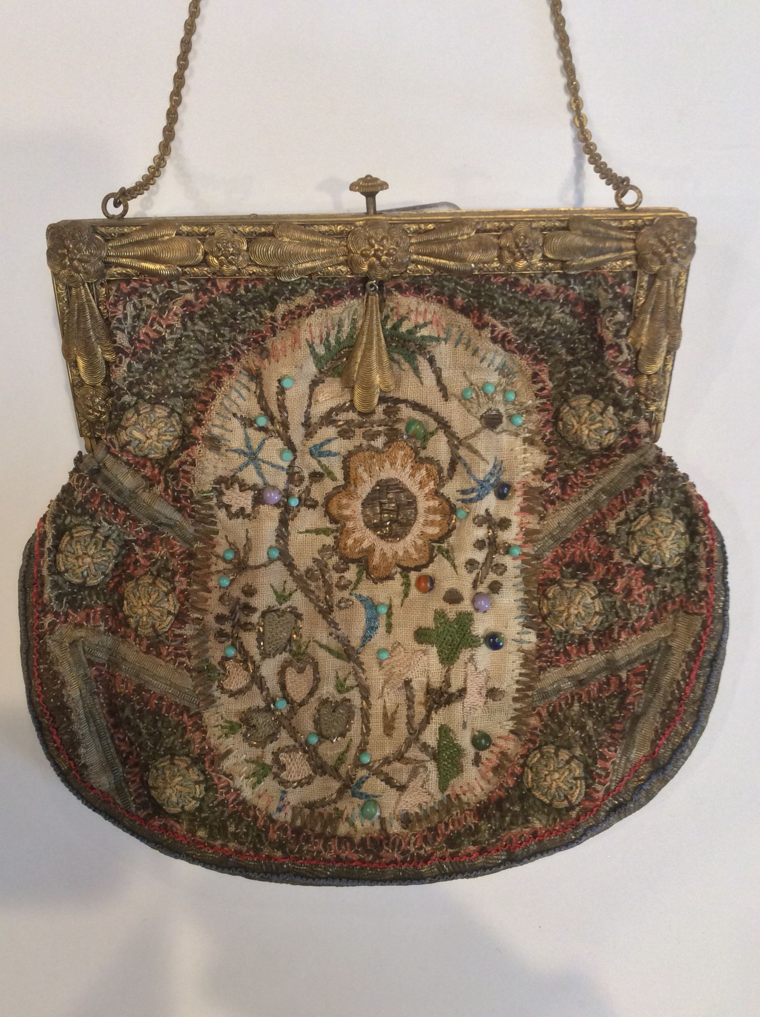 Antique/ vintage, brass  frame with textile base. Heavily embroidered with bead  and bullion accents.  ThePurseMuseum.com
