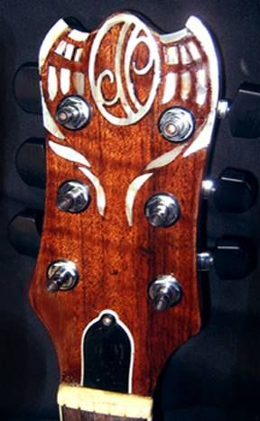 """""""CROSSROADS SG"""" for the National Guitar Museum"""" Carved by Doug Rowell, sculptor and wood carver in 2013. As Doug says: """"I was contacted by the National Guitar Museum in 2013 with the prospect of creating a guitar for display in their museum. They said they liked the bare, open tree design on my """"Punkin Patch"""" and """"Goth"""" Gibson SG pieces. They agreed to send me a body and neck for the project. """" Completed May 20, 2013"""
