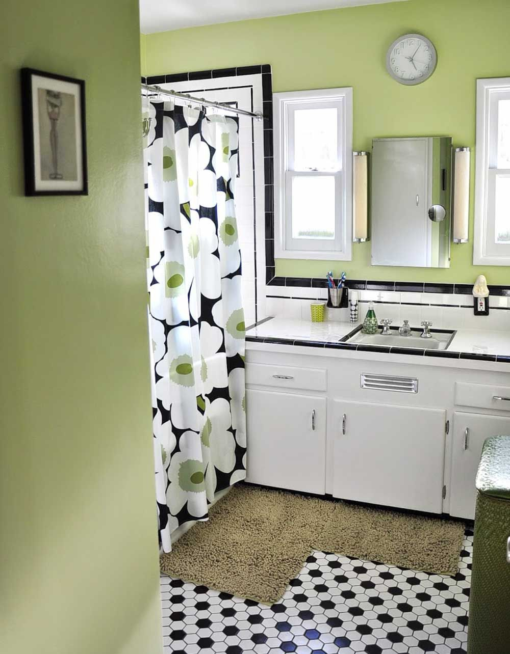 Black and white tile bathrooms done different ways