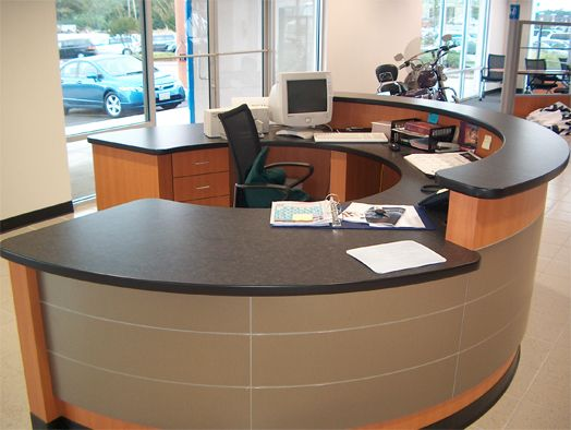What type of desk works well for an office receptionist?