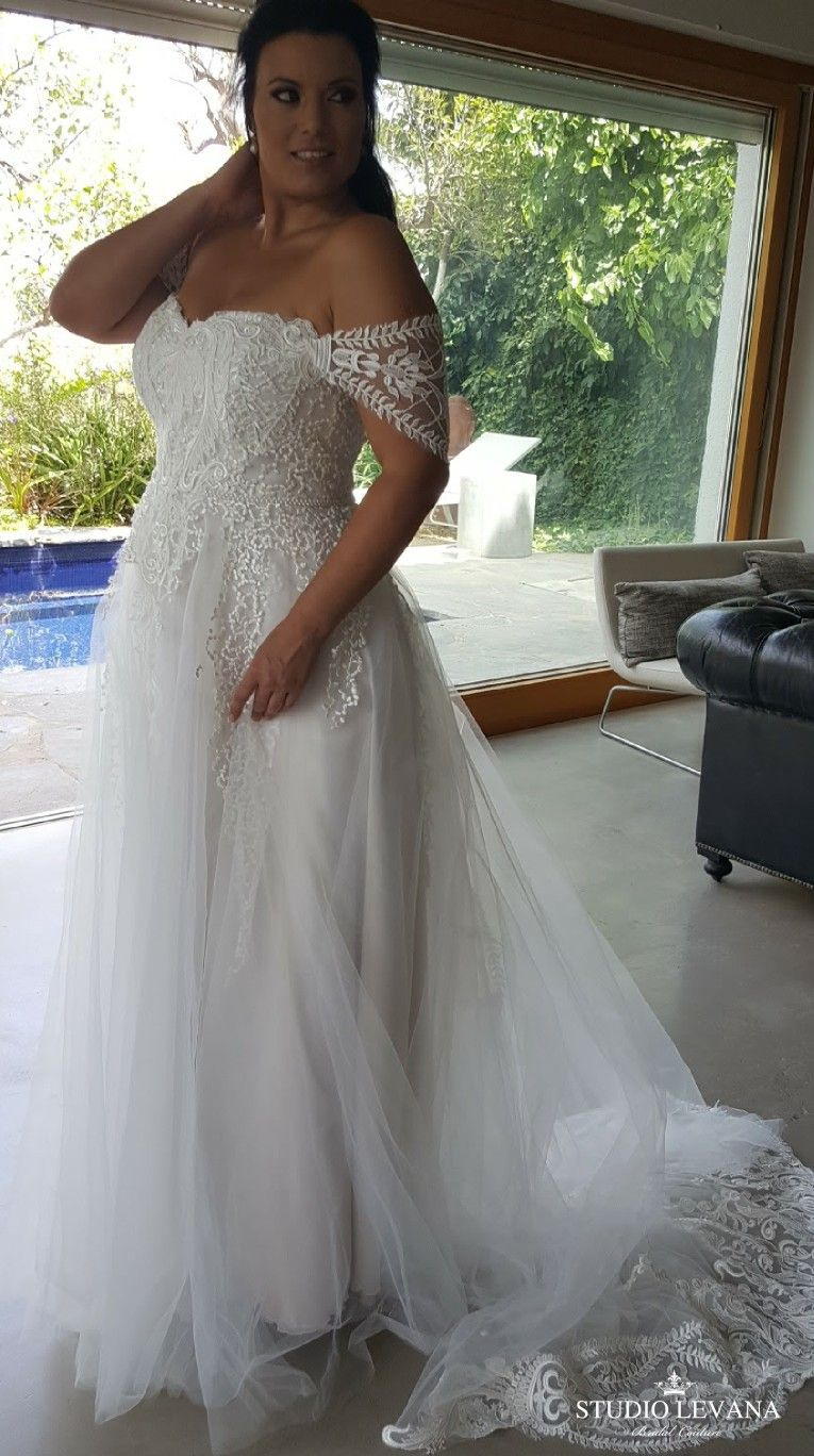 Stunning princess plus size ball gown with unique off shoulder