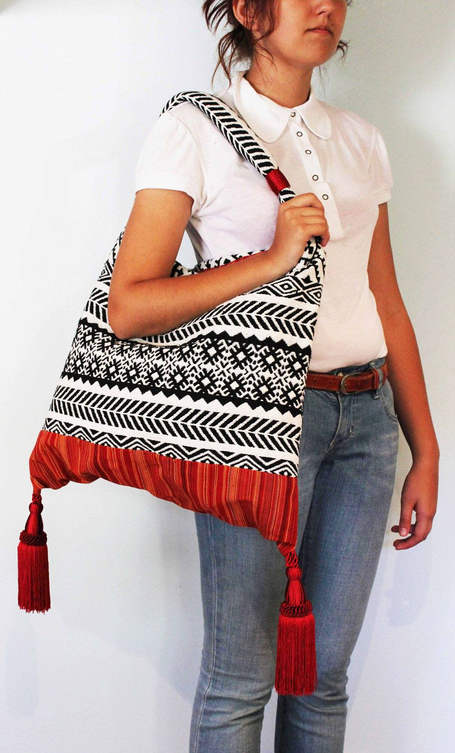 Fantastic Super Comfortable Ethnic Style Textile Bag with red tassels, metal zipper and internal pokets. $89.00, via Etsy.