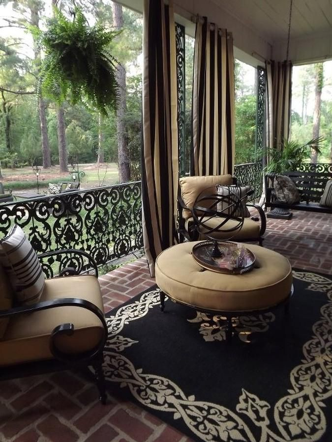 wrought iron framed porch Curtains and rug