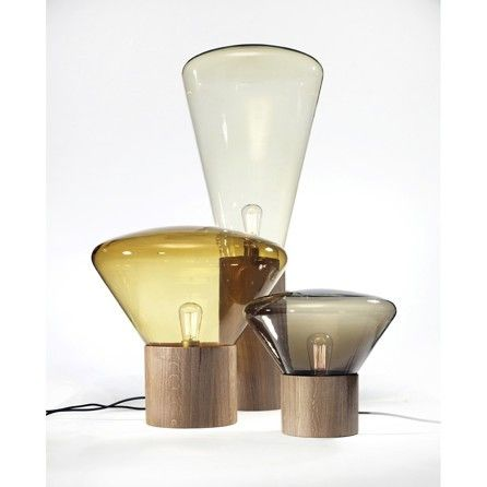 Muffins lamps are born of the notion of combining oak and blown glassThis series of lamps creates a unique atmosphere through the glass' varied tones and tints, while retaining complete functionality.