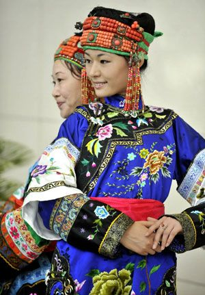 Mongolia |  The women's costume of Mongolian ethnic group from Ongniud.  Displayed during a cultural festival in Hohhot, capital of north China's Inner Mongolia Autonomous Region