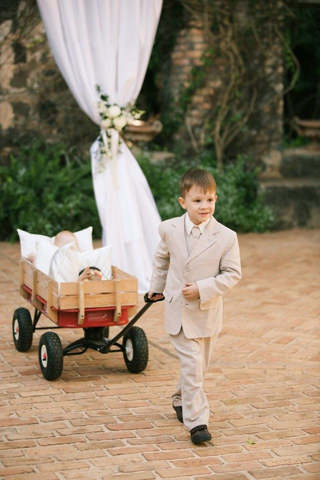 How Adorable Ring Bearer Pulling The Baby Flower Girl In Her Little Red Wagon Anna Kim Photograph Wagon For Wedding Hawaiian Wedding Ring Bearer Flower Girl