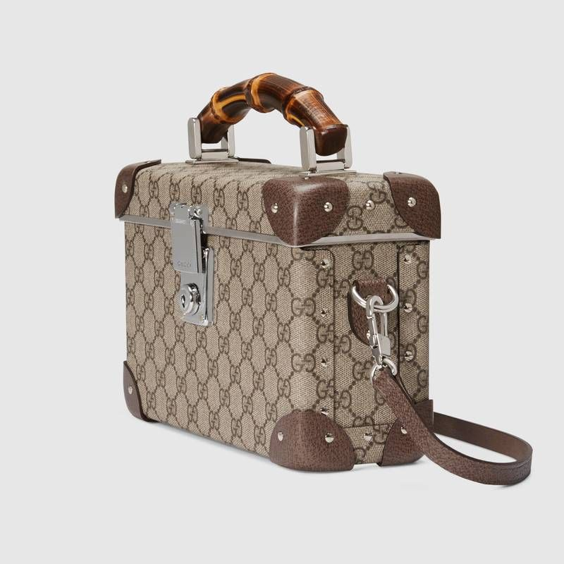 ee733dffd190c8 Shop the Globe-Trotter GG beauty case by Gucci. Completed with a bamboo  handle