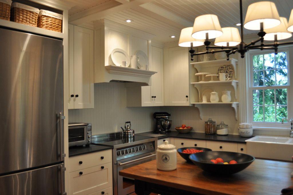Baskets Above Frig Modern Kitchen Countertops