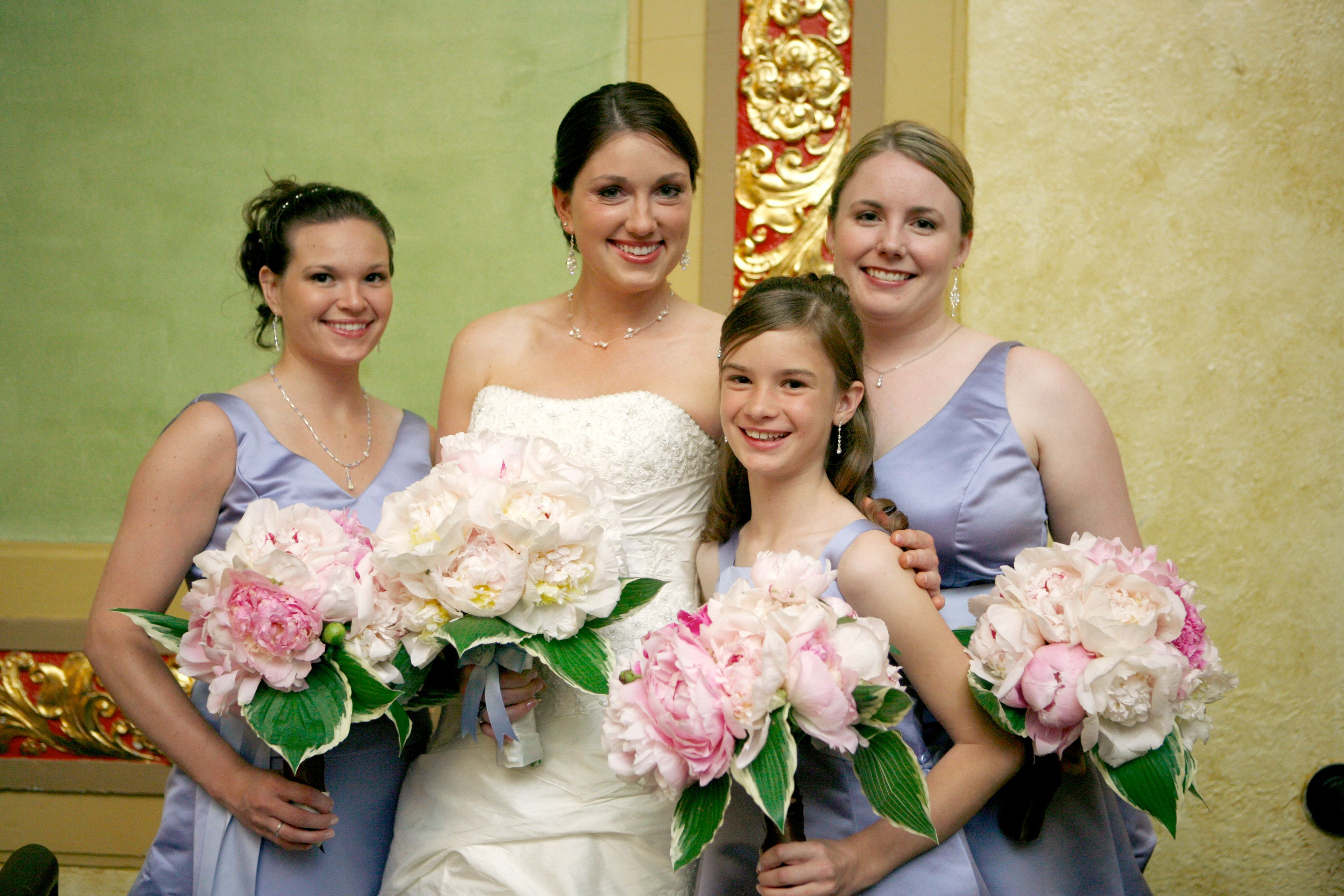 bride and bridesmaids bouquets | it is surrounded with green and white variegated hosta leaves and hand ...