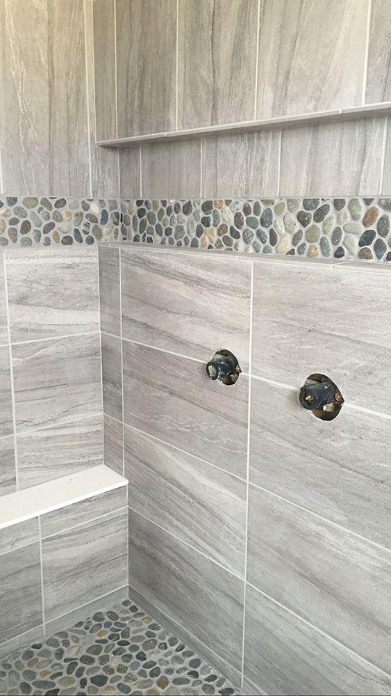 sliced java tan pebble tile shower floor. https://www