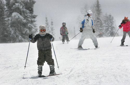Kids come down the hill at Solitude Ski Resort Sunday, April 3, 2011