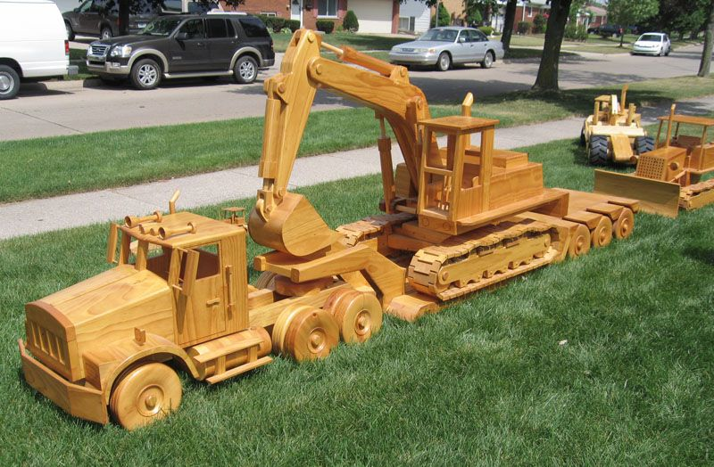Wooden Construction Toys : A yard full of wooden construction equipment models in