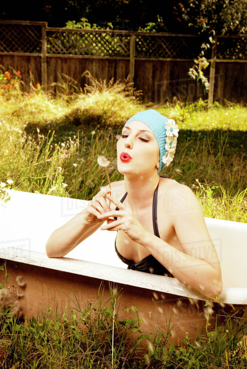 Pinup in the tub stock image. Image of soap, washtub