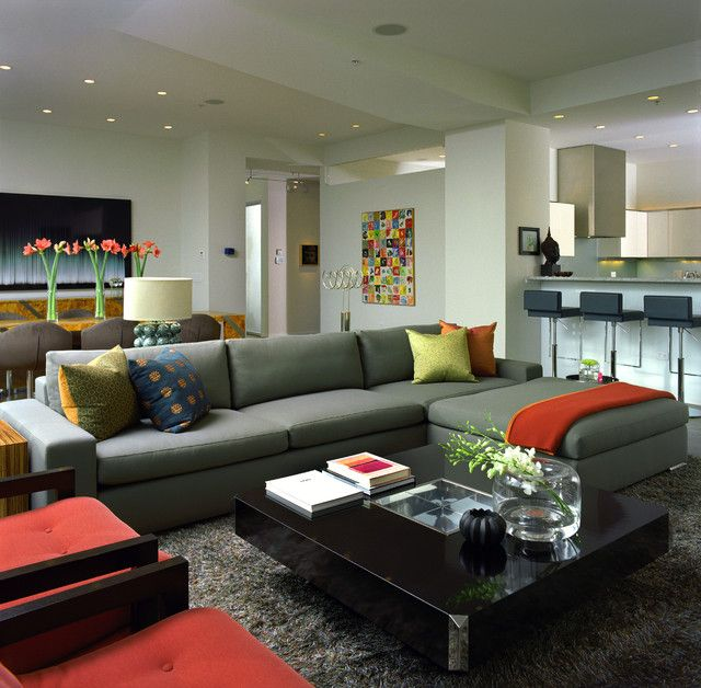 Stylish Living Room Involving Gray Sectional Sofa Combined With Red Chairs  And Black Coffee Table With