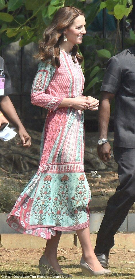 Looking relaxed: William and Kate go for a stroll in the sunshine on the Oval Maidan recreation ground in the city of Mumbai