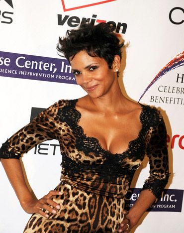 Halle Berry Shows Off Her Shapely Figure In A Tight, Leopard-Print Dress