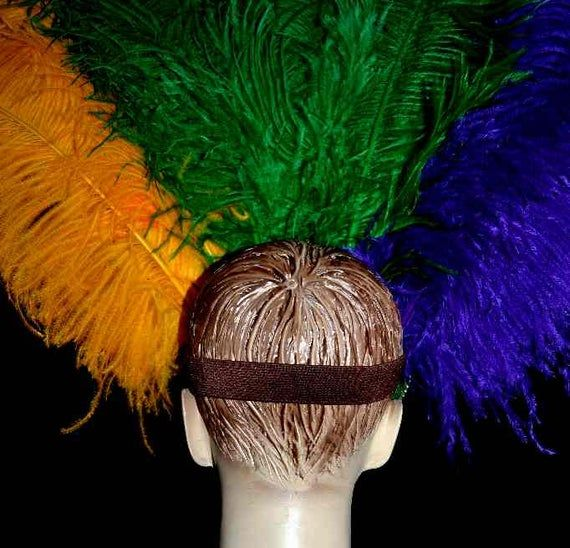 We make and ship our items really fast if you need it for a specific date please let us know. or call/text us at 954-3051817 to complete your order over the phoneFull size best quality Prime Ostrich Plumes Feather Carnival Headdress Showgirl  Rainbow Mardi Gras colors  on a gold sequined crownFeather Colors Yelow Gold, Purple and GreenA miamifeathers originalAll the items are new!Crown color: gold..................Please Note: We guarantee that we will send your item by the date our processing t