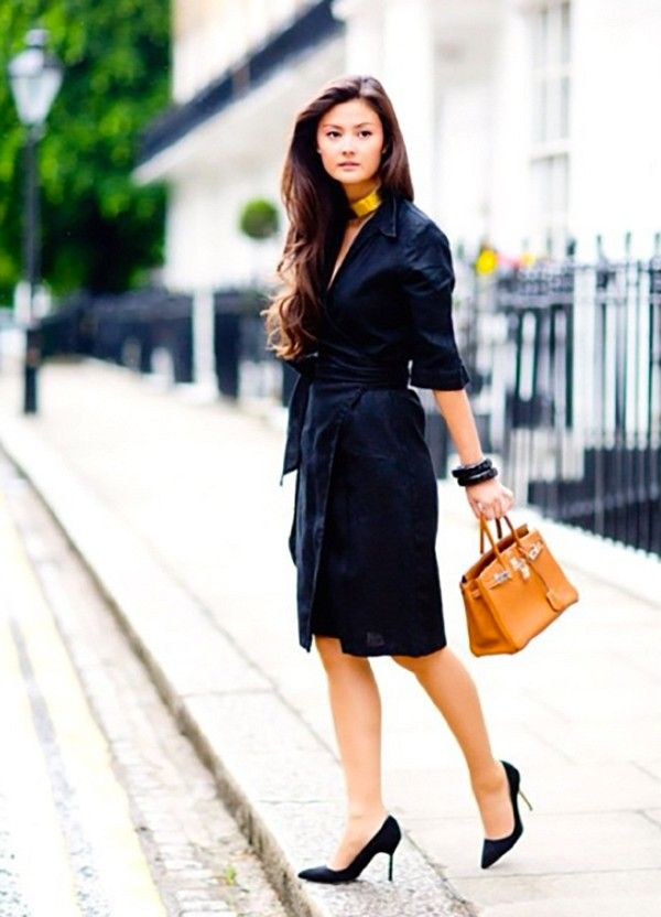 A feminine look is curated with a wrap dress and classic pumps.