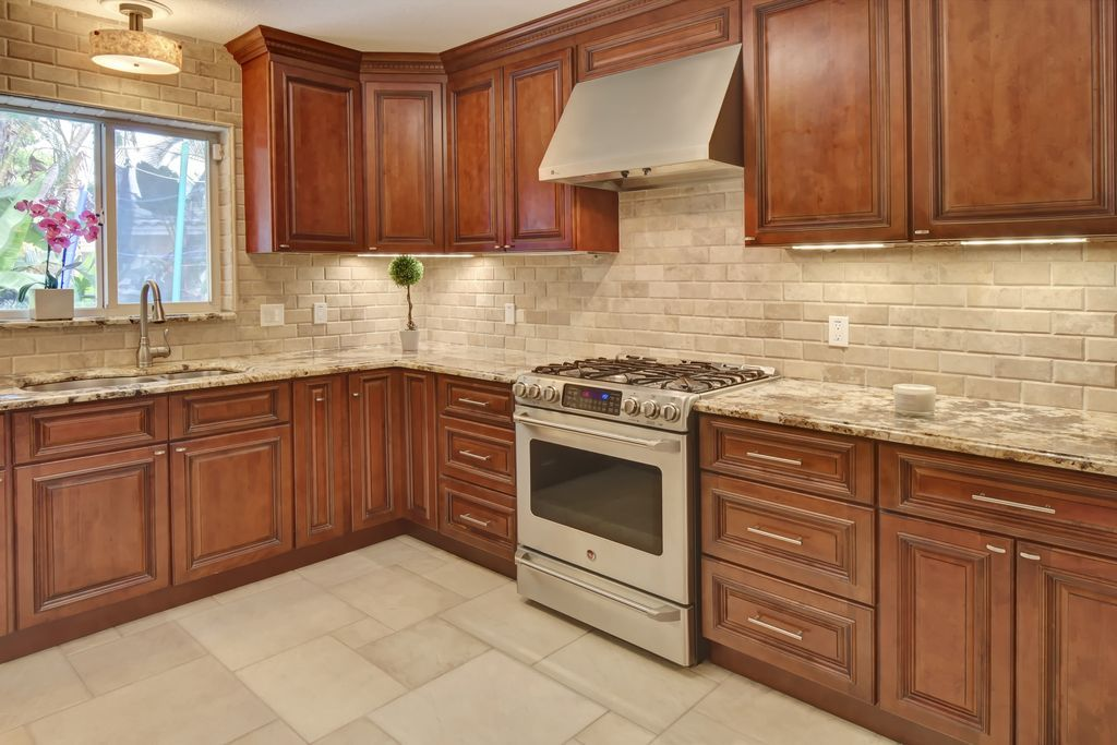 Traditional Kitchen With L Shaped Tuscany Walnut Subway Tumbled
