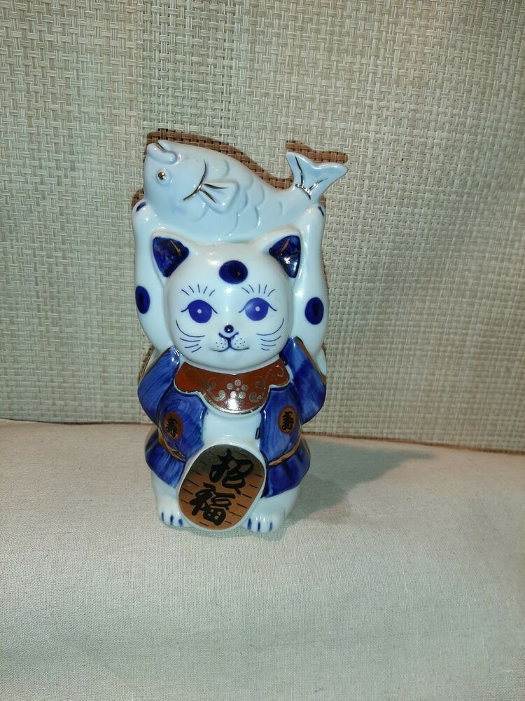 Porcelain blue and white Cat Figure Holding Fish over his