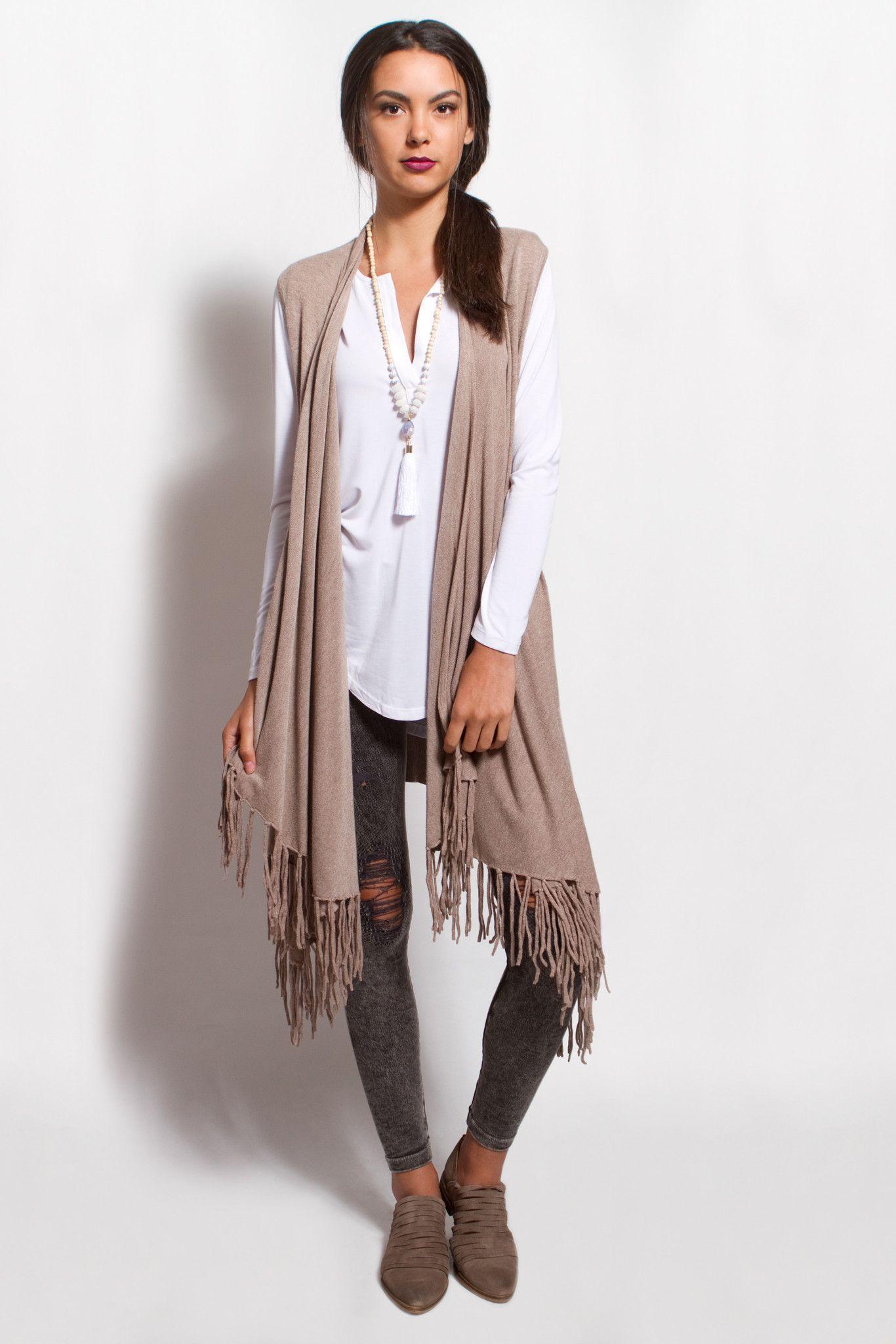 Sleeveless, shawl collar, knit sweater vest with fringe hem ...