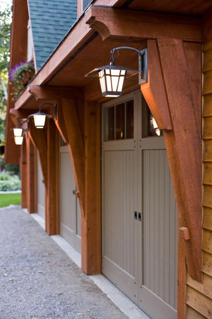 Garage door overhang garage overhang with lights cabin for Craftsman style garage lights