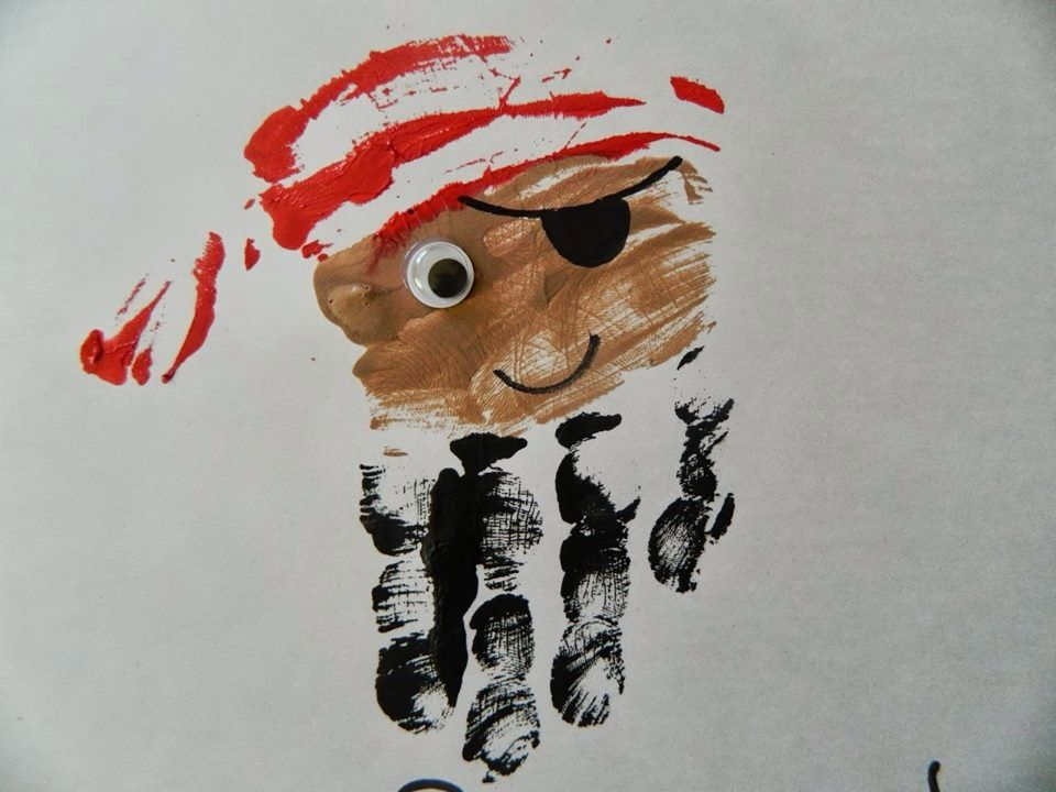 Hand print on a pirate - cute! could even use paint for the eyes. that is what I do...