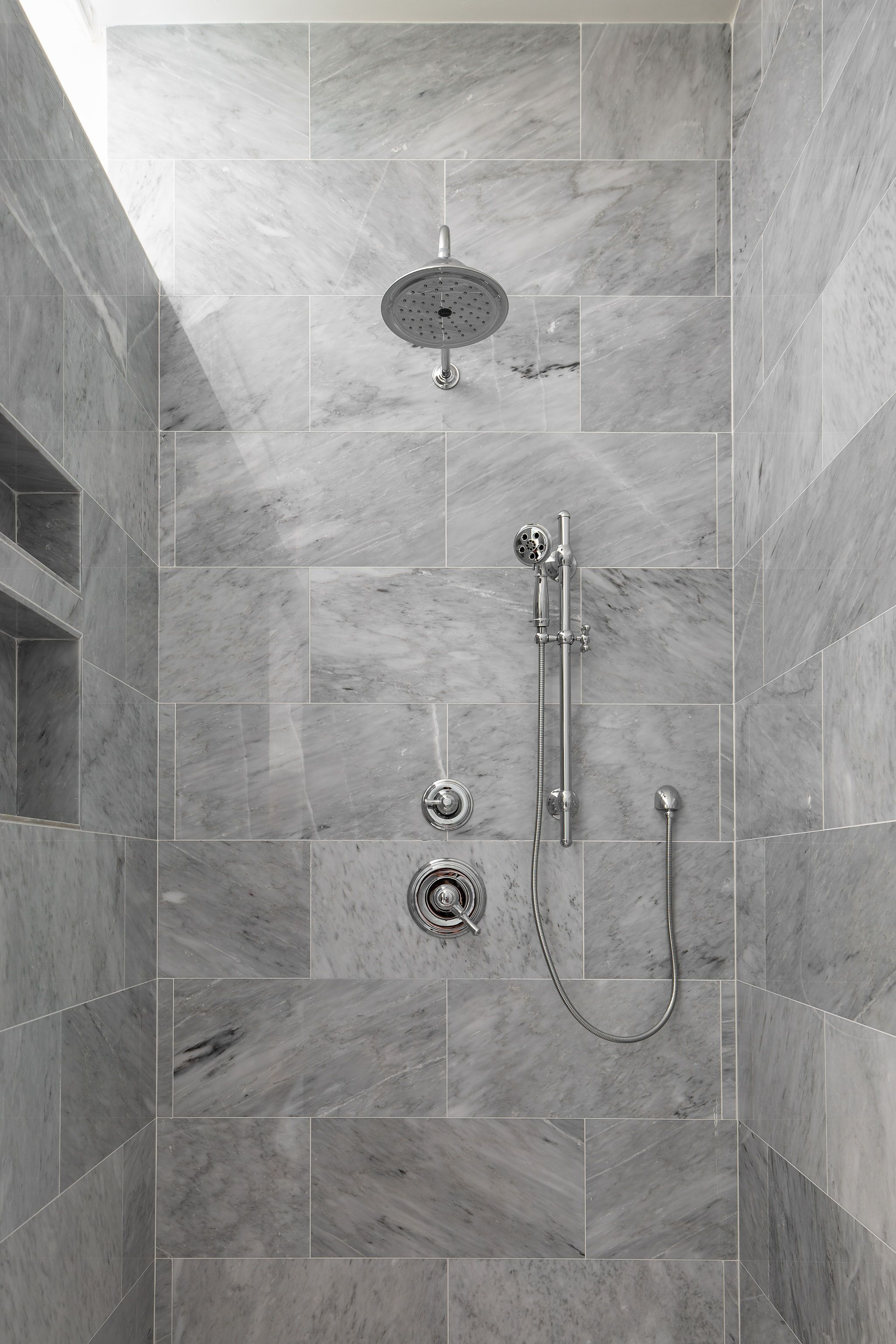 Gray Marble Shower With Brick Lay Tile And Silver Plumbing With
