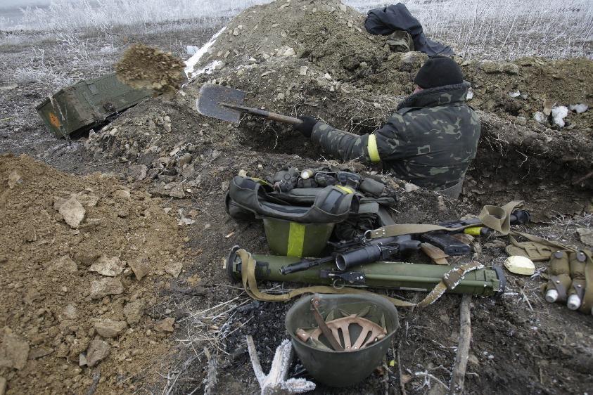 soldier digs in as Ukrainian forces take positions not far from Debaltseve, Donetsk region on February 14, 2015