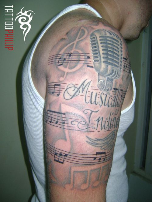 music sheet half sleeve tattoos musically inclined half sleeve tattoo picture at. Black Bedroom Furniture Sets. Home Design Ideas