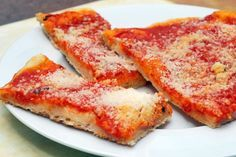 Tomato Pie - A Utica classic.    It's not quite a pizza.  Most of the time we eat it cold.  It's almost ALWAYS seen at parties.