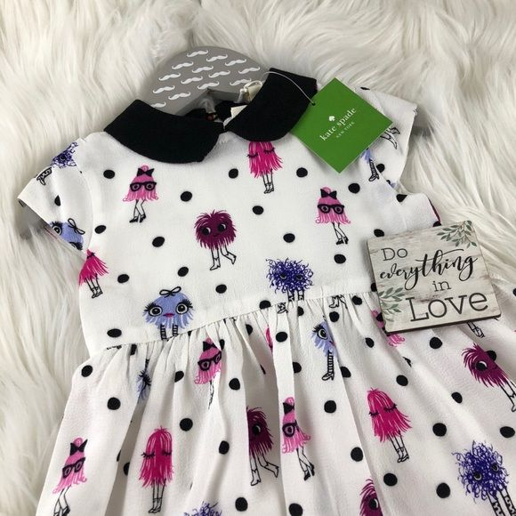 Kate Spade LAST ONE Monster Babies Dress Set 12mo Kate Spade cute hairy monsters on an adorable cap sleeve dress paired with matching bloomers.  2 piece set.  12mo - #0706 18mo - #0705   📐 Information 📐   Dress Peter Pan collar Cap sleeves Back zip closure Allover Print Solid lining Body 100% viscose Lining 100% polyester  Bloomers Elastic waist and legs Allover Print 100% viscose kate spade Dresses