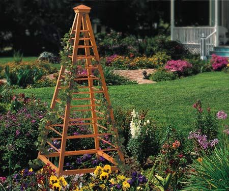High Quality Typically Constructed Of Wood Lattice, A Garden Obelisk Is Basically A Free Standing  Trellis. When Situated Near Climbing Plants Such As A Black Eyed Susan ...