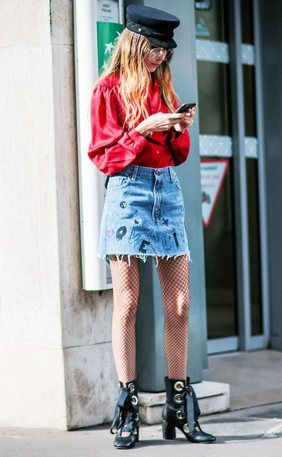 6ef0cc5f447 This trend is about to replace the choker.. can you guess what it is    Loving this denim skirt paired with lace up boots and a newsboy cap.