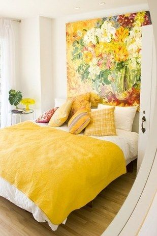 To create unity, use different shades of the same color. For the wall, rug and furniture using different shades of the same color creates a visual coherence that makes the space feel open. If you're not in the market for new furniture, adding a throw or pillows or accessories in the same shade can give you the same effect.