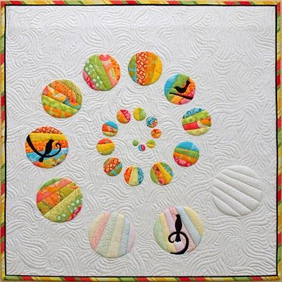 So clever!  I wonder if those lighter colored ones are done as shadow applique.  Beautiful quilting, too.