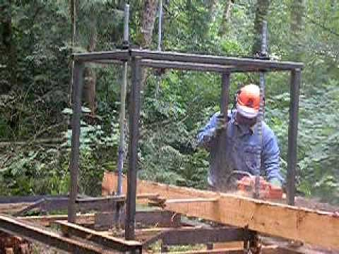 Carriage chainsaw sawmill cutting cedar beams - YouTube
